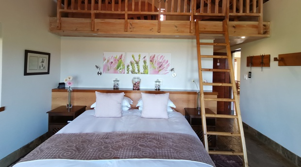 King size bed and two single beds on the loft